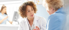 A physician talks to her patient